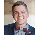 Smiling young man wearing bow tie