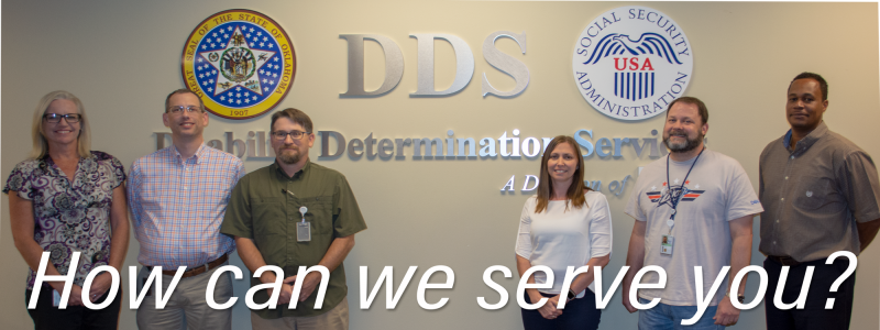 Six DDS employees stand in front of the DDS, Oklahoma Seal and SSA Seal. With 'How can we serve you?