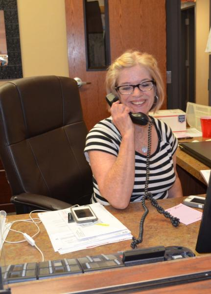 Gallagher at her desk on the phone.