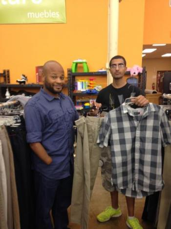 An African American young man and hispanic young man pick out job appropriate clothes