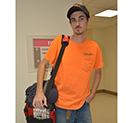 Man wearing cap holds a large bag over his shoulder - for facebook