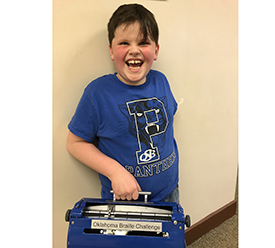 Smiling boy holds equipment