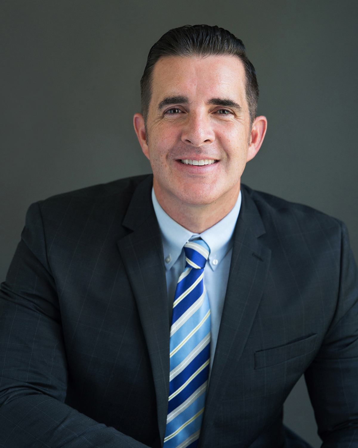 Smiling man wearing suit and tie