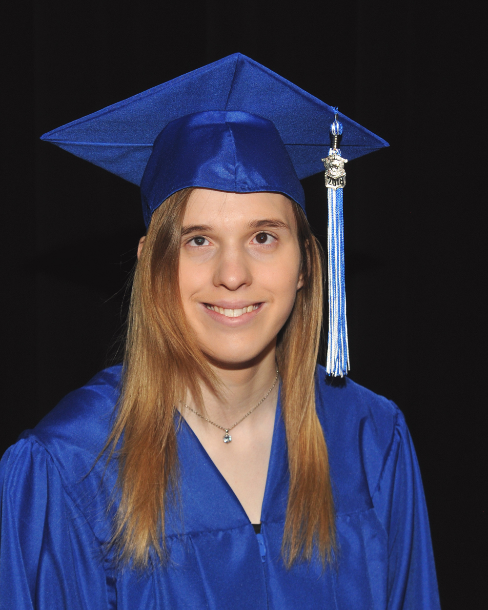 Peters in cap and gown.
