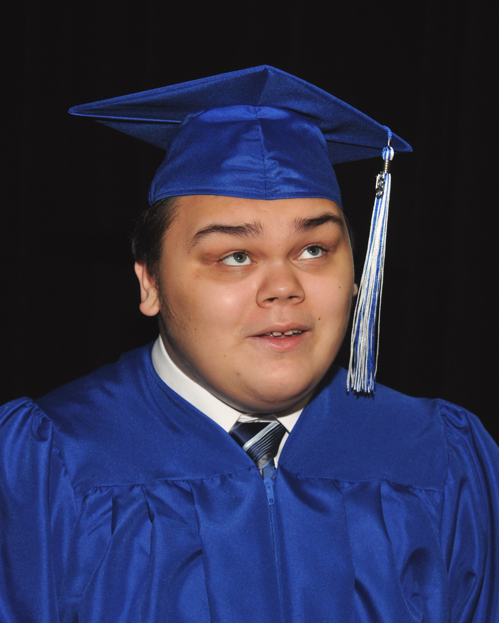 Rodriguez in cap and gown.
