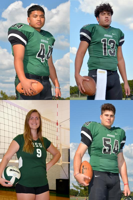 3 male football planers and one female volleyball players in uniform with sports balls