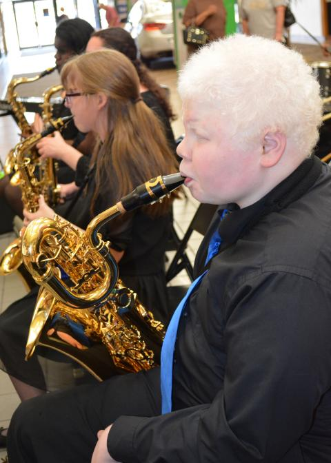 Boy and girl play horns in a band