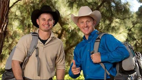 Two men wearing cowboy hats.