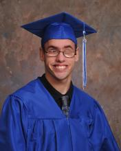 Portrait of Hilton in his cap and gown
