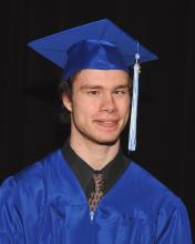 Hughes in cap and gown.