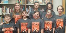 Six young people and two adults wearing Battle of the Boos tshirts