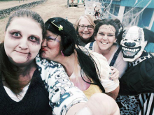 Five ghoulish adults pose in Halloween costumes