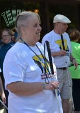 Woman holds white cane and stands in front of man holding white cane
